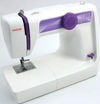 TOYOTA BL 16 - • 16 программ шитья  • Петля полу-автомат • Встроенная намотка шпулек  • Прямая строчка • Зиг-заг